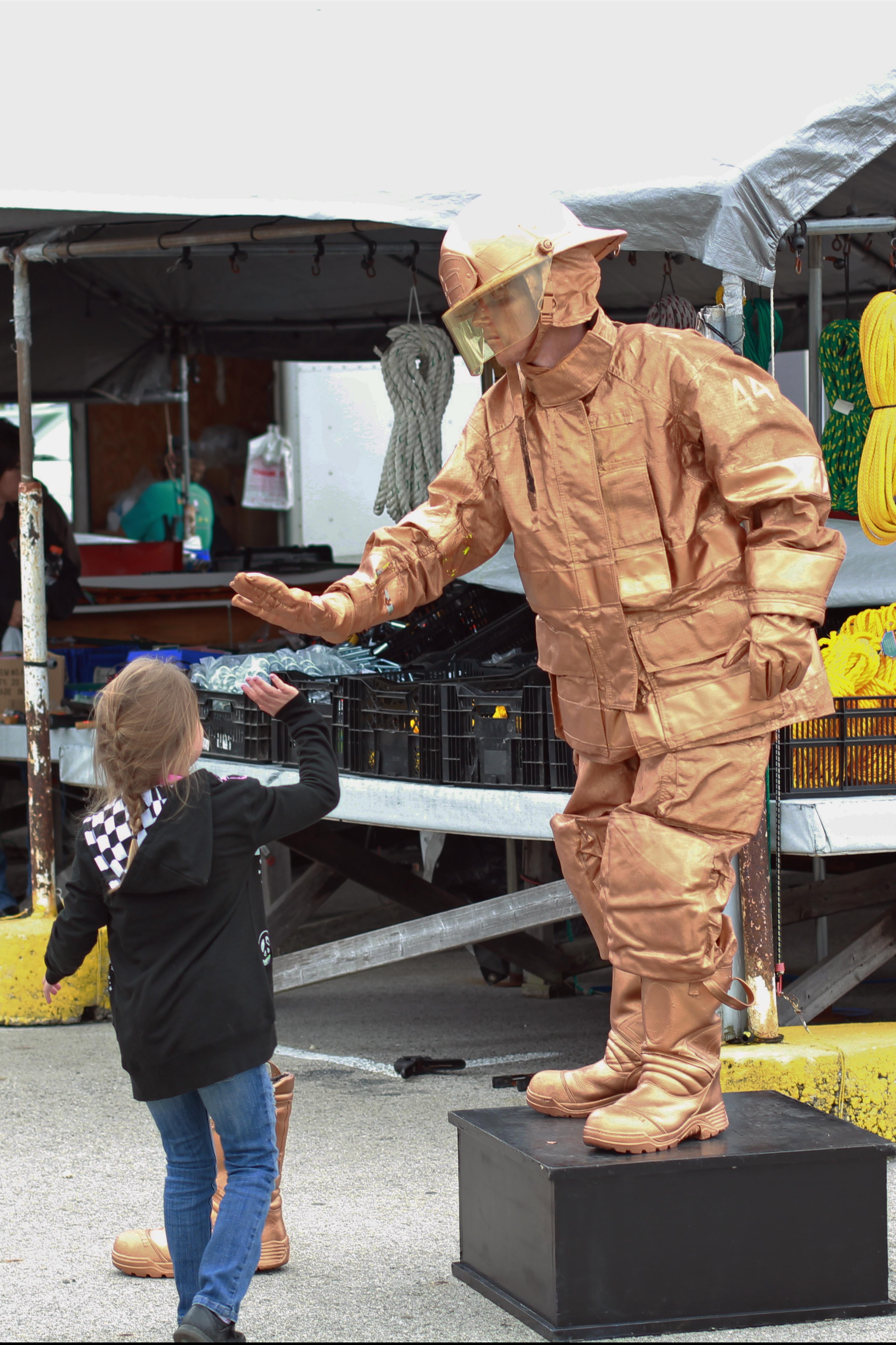 Gold Fireman Living Statue