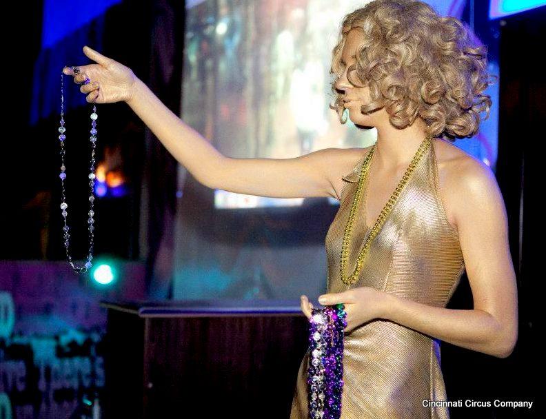 living statue gold girl mardi gras kim